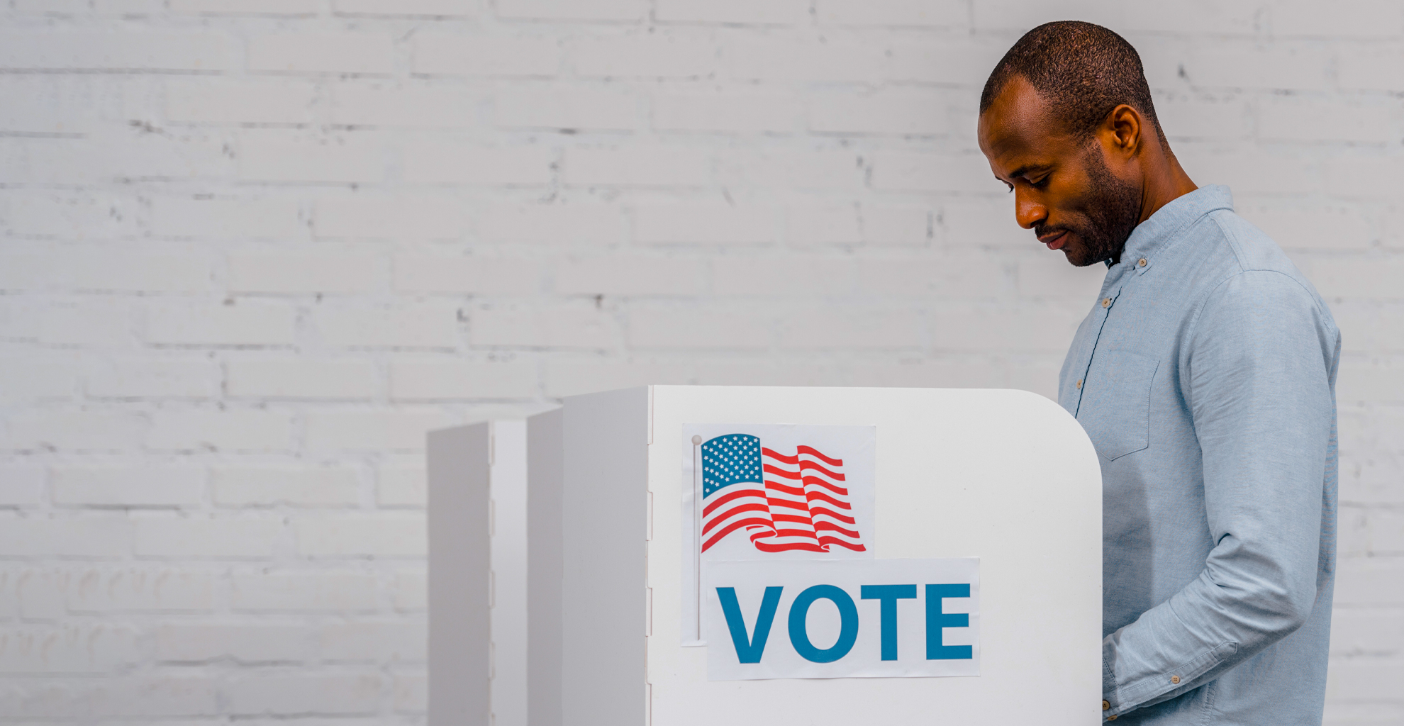 Man voting at a voting booth